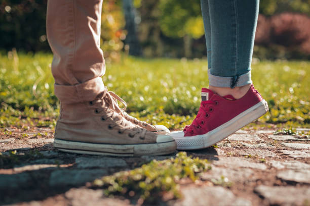 Couple legs in sneakers stock photo