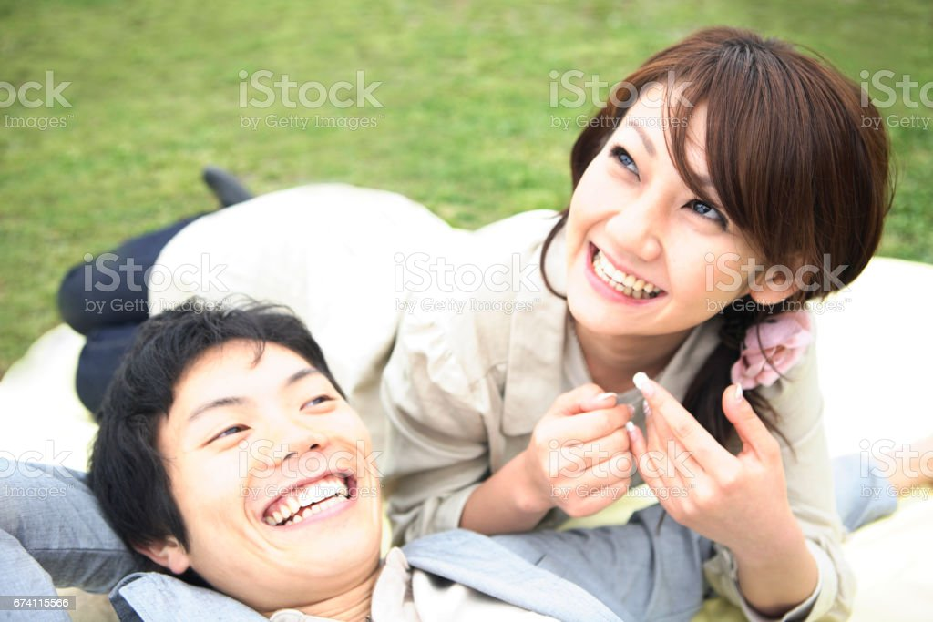 A couple lie down royalty-free stock photo