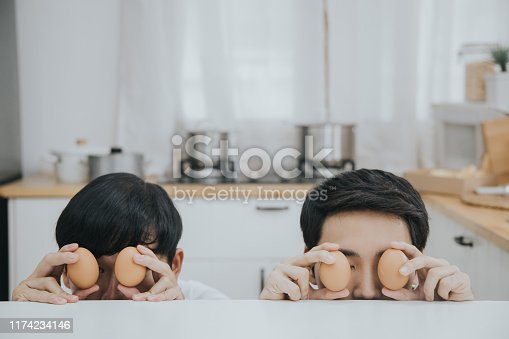 egg, cooking, kitchen, men, homosexual couple, enjoyment, domestic life, Bangkok, Thailand, Southeast asia, eating