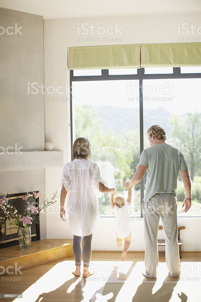 Couple lifting baby son in living room royalty-free stock photo