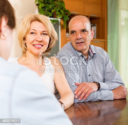 584597964 istock photo Couple listening employee of company 500279217
