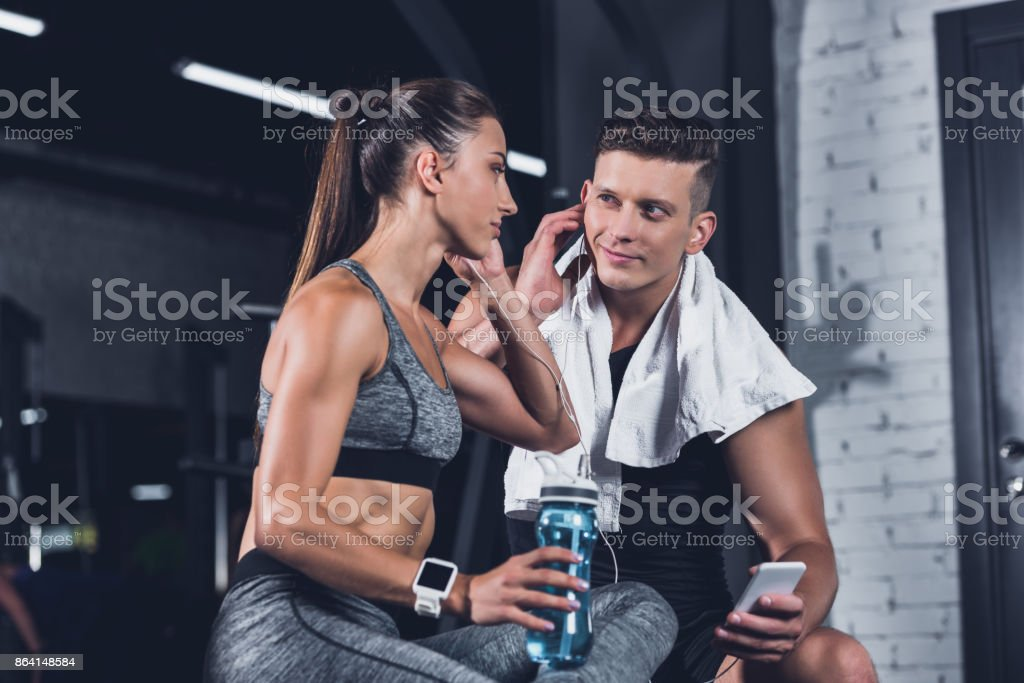 couple listening music in gym royalty-free stock photo