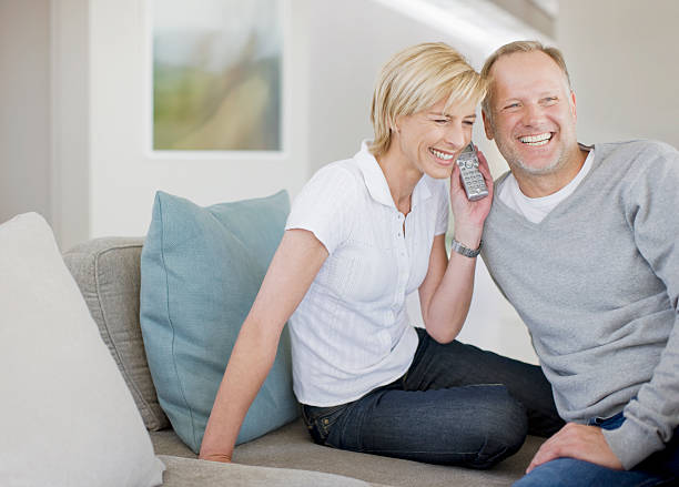 Couple listening to cordless phone together  cordless phone stock pictures, royalty-free photos & images