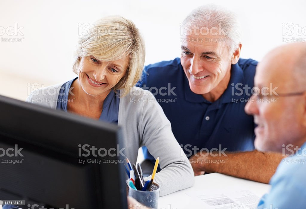 Couple listening to their financial advisor royalty-free stock photo