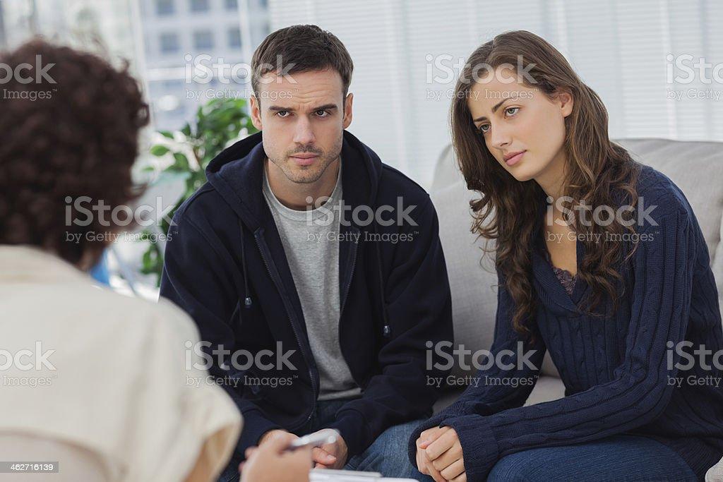 Couple listening to therapist stock photo