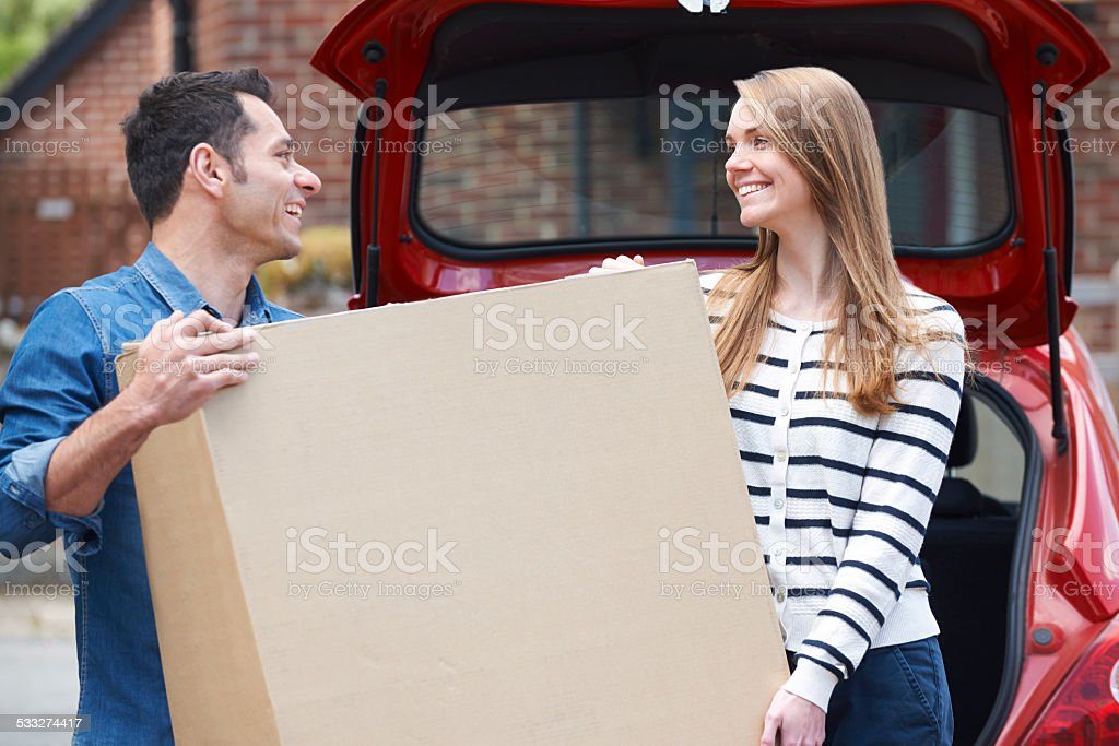 Couple Loading Purchase Into The Boot Car stock photo