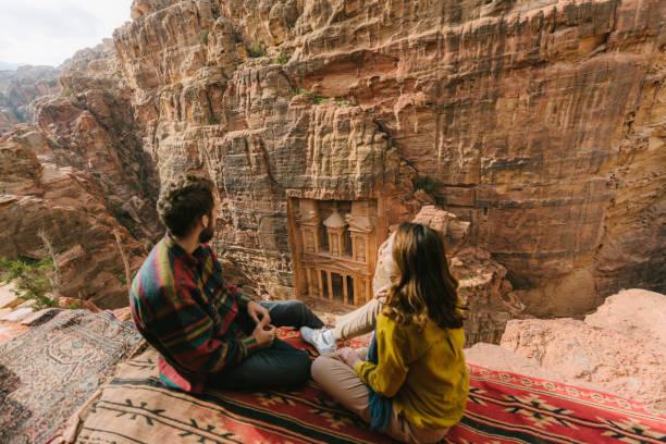 Couple looking at Al-Khazneh in Petra stock photo
