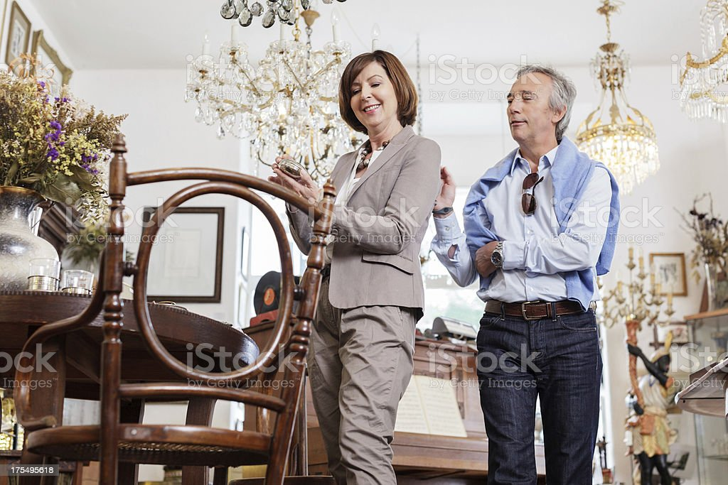 Couple looking at antique Items stock photo