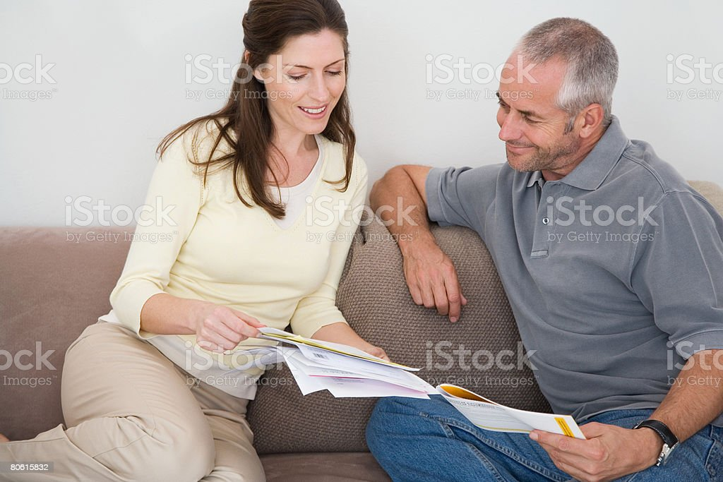 A couple looking at bills royalty-free stock photo