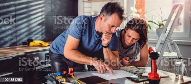 Couple looking at blueprints during kitchen renovation picture id1004381280?b=1&k=6&m=1004381280&s=612x612&h=rzwto mqrzcxd00ispuv8kaxlt8kkzw1u3y1pxpqshq=