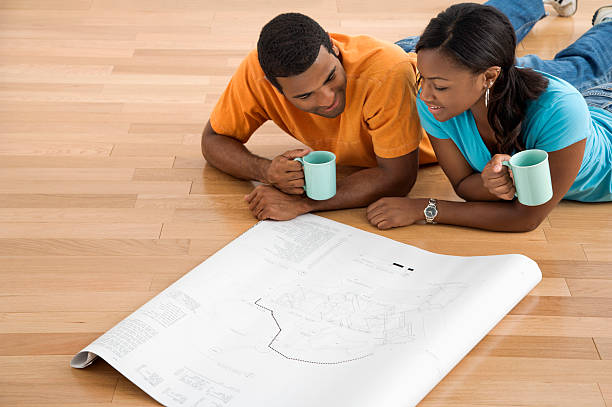 Couple looking at blueprints. stock photo