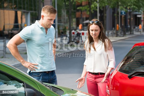 1047083324 istock photo Couple Looking At Car Collision 844209540