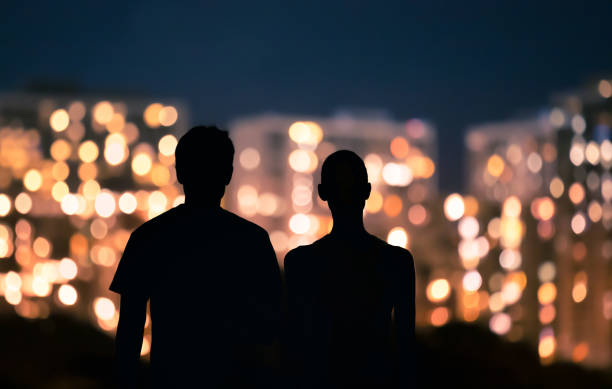 Couple looking at city lights stock photo
