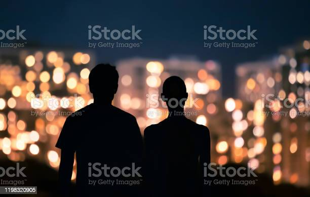 Photo of Couple looking at city lights