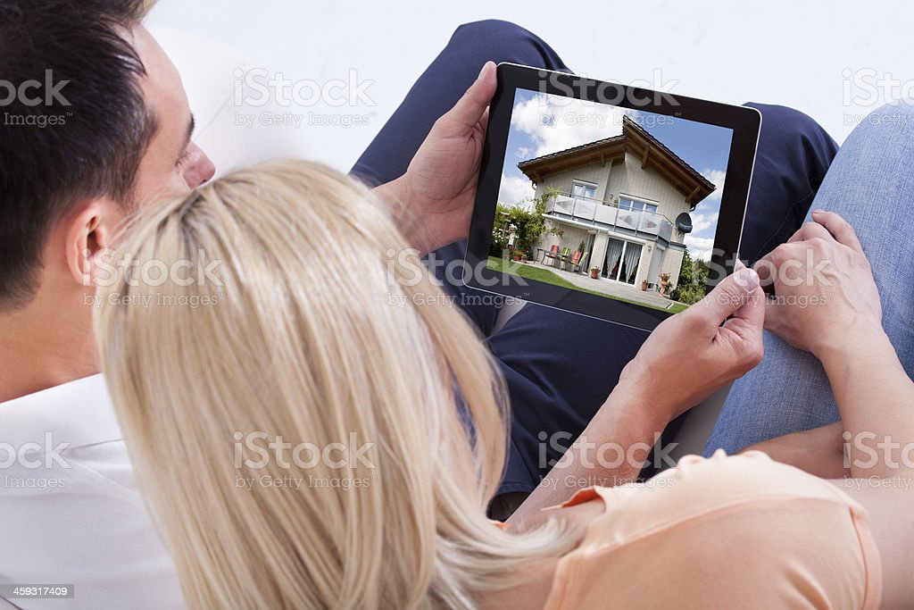 Couple Looking At Digital Tablet stock photo