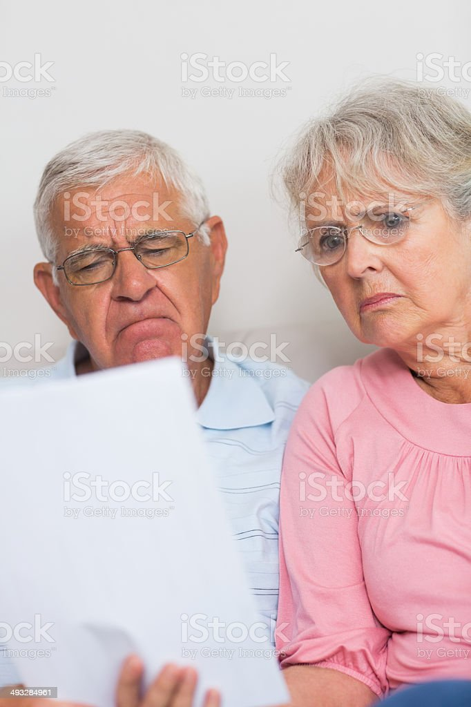 Couple looking at home finances royalty-free stock photo