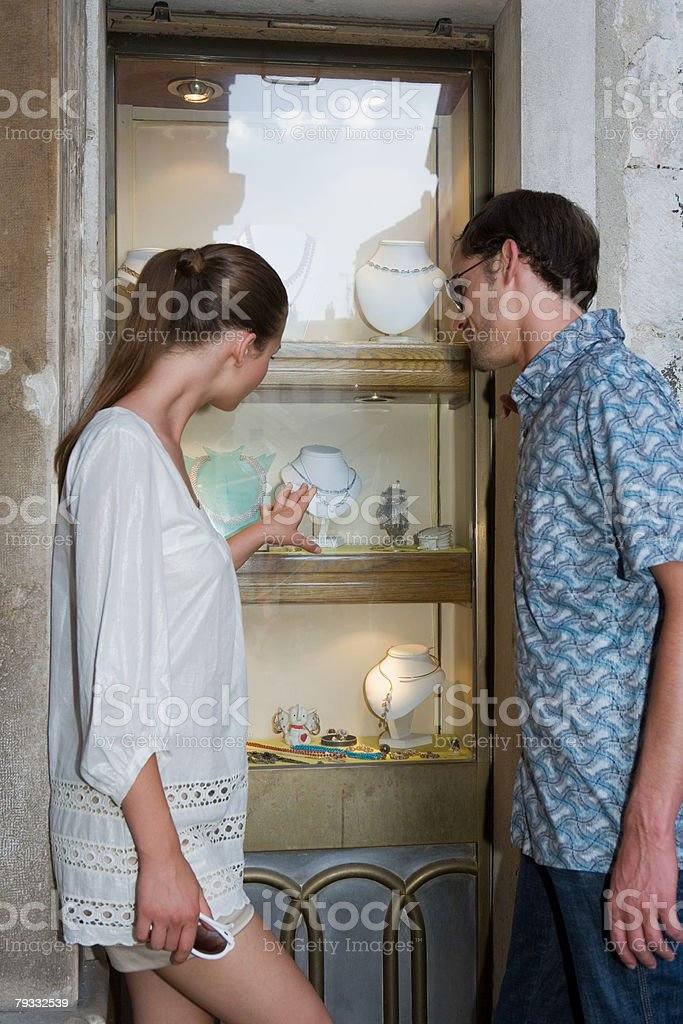 Couple looking at jewelry royalty-free stock photo