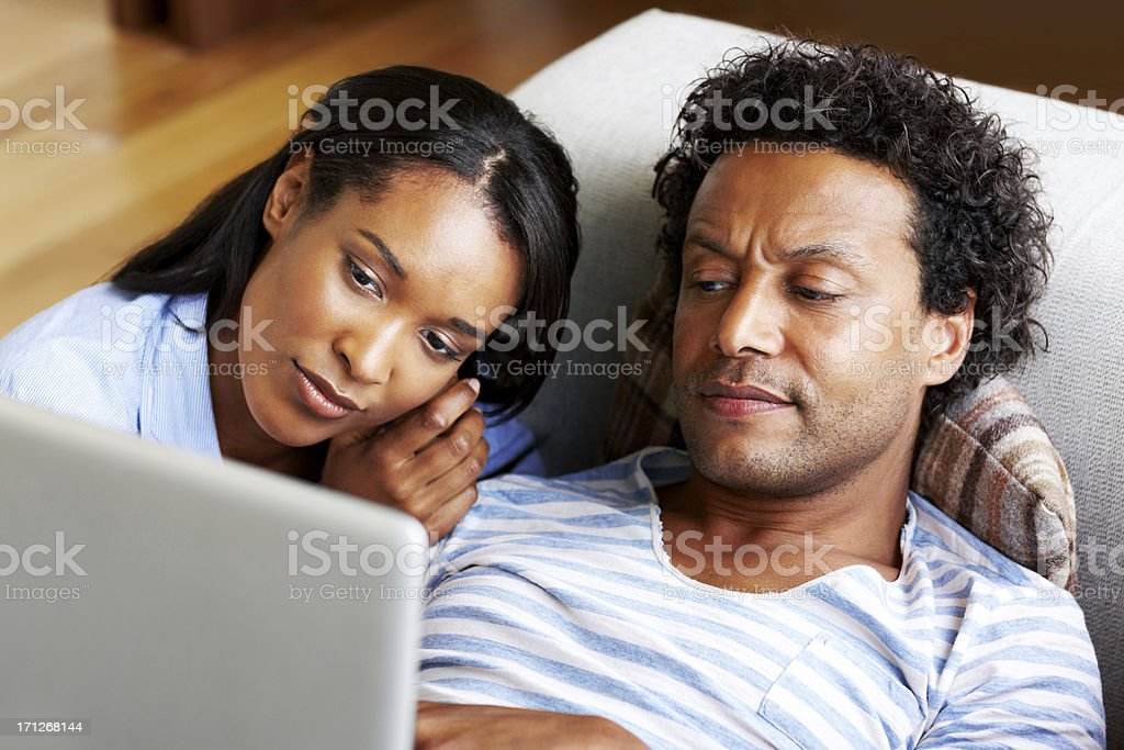 Couple looking at laptop - Indoors royalty-free stock photo