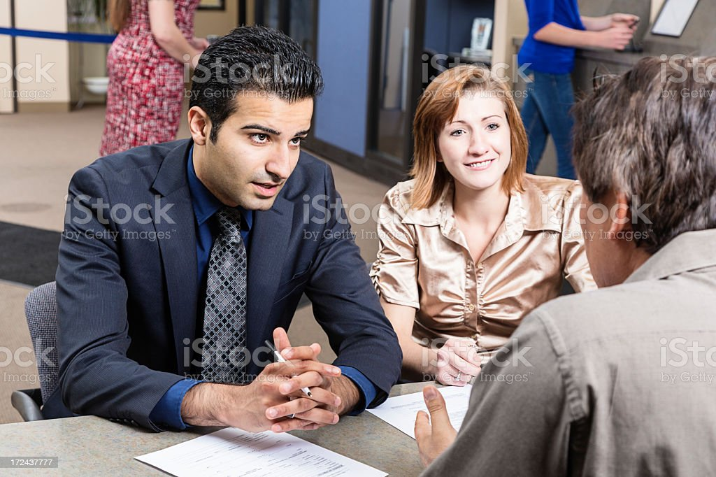 Couple looking at loan application royalty-free stock photo