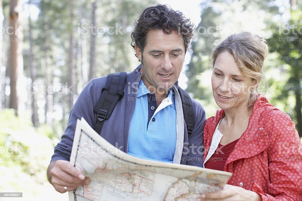 Couple looking at map royalty-free stock photo