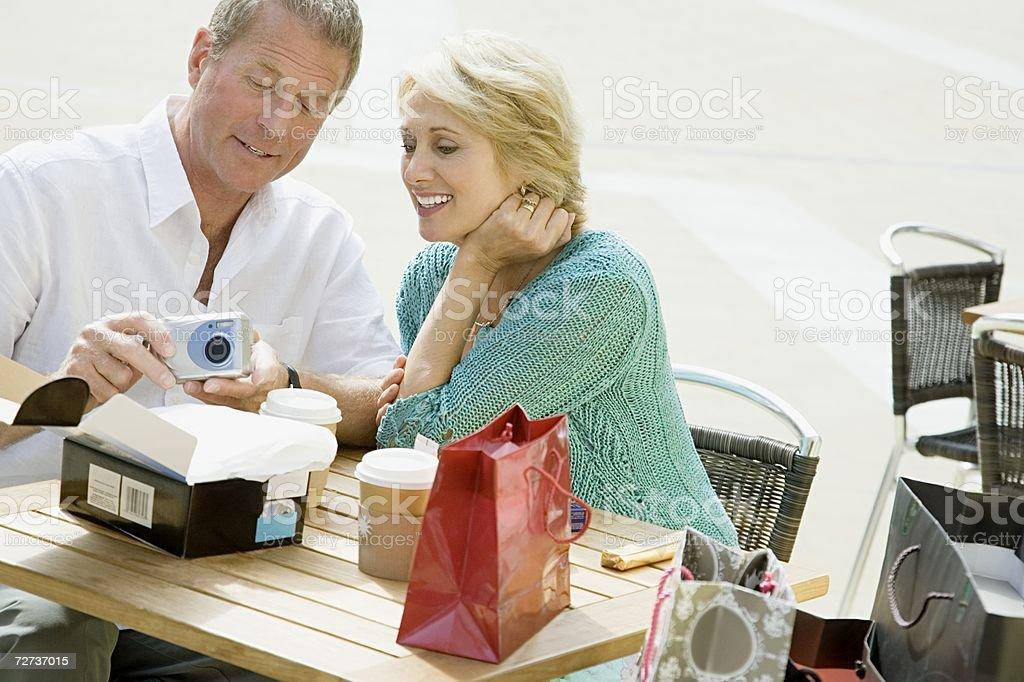 Couple looking at new camera royalty-free stock photo