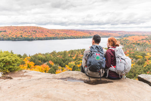 couple looking at panorama from the top - canada travel stock photos and pictures