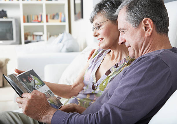 A couple looking at pictures stock photo