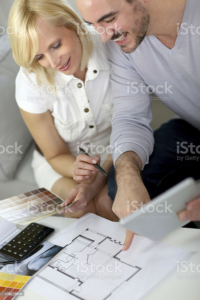 Couple looking at plans for their future house royalty-free stock photo