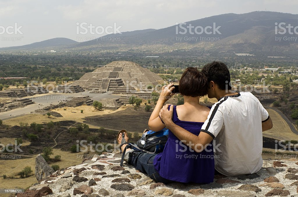 Couple looking at Pyramid of the Moon in Teotihuacan Mexico stock photo