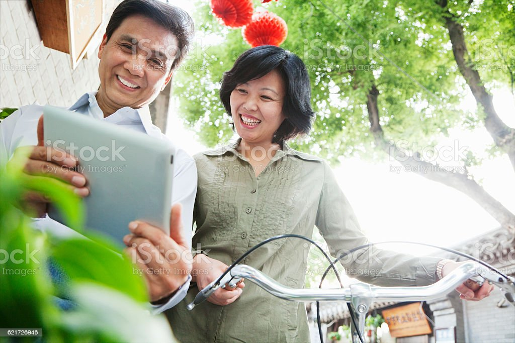Couple looking at tablet computer stock photo
