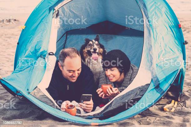 Couple looking at the smart phone and have fun inside a tent in free picture id1086932792?b=1&k=6&m=1086932792&s=612x612&h=gxfunoe3f xgid1i9eevzlfxrfw605shjgbeyj2qlsw=