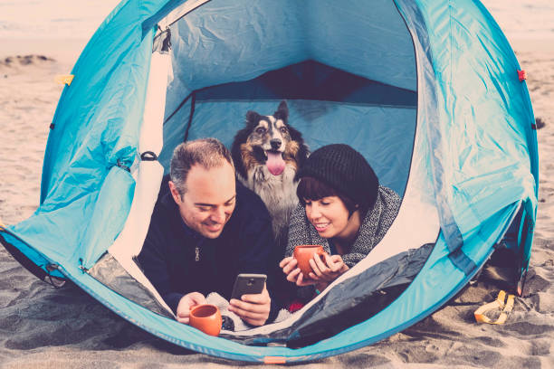 Couple looking at the smart phone and have fun inside a tent in free picture id1086932792?b=1&k=6&m=1086932792&s=612x612&w=0&h=0uvdrdmq9l2c9mz7hx7k8wdwmibwdqbawsb  oxp t0=