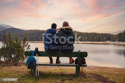 Couple looking at view in autumn near Mountain Lake