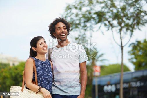 Happy multi-ethnic couple looking away outdoors