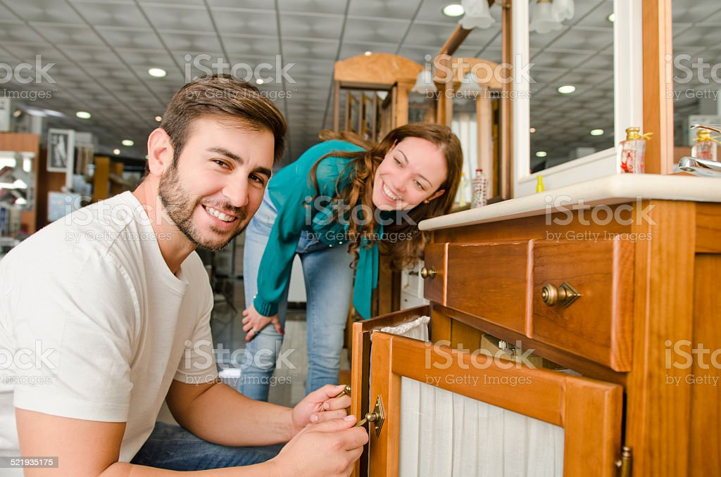 Couple looking bath furniture at big store stock photo