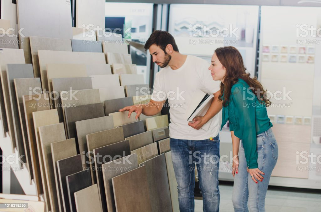 Couple looking ceramic and tiles for their new home floor stock photo
