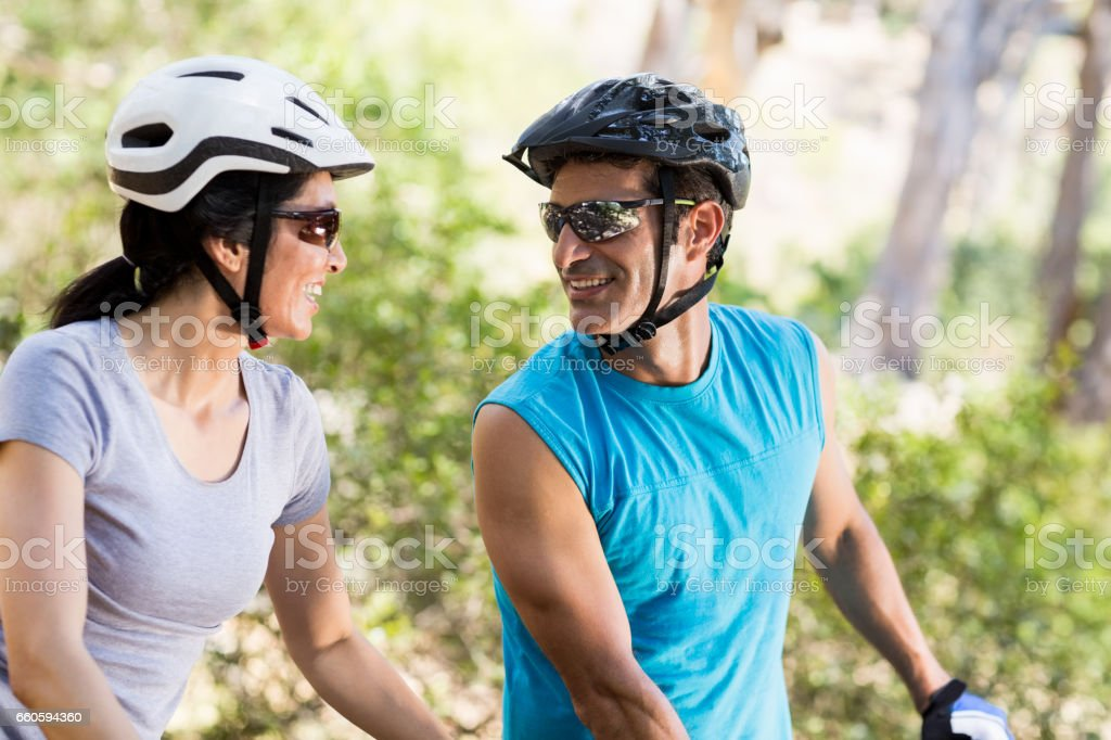 Couple looking each other with their bikes royalty-free stock photo