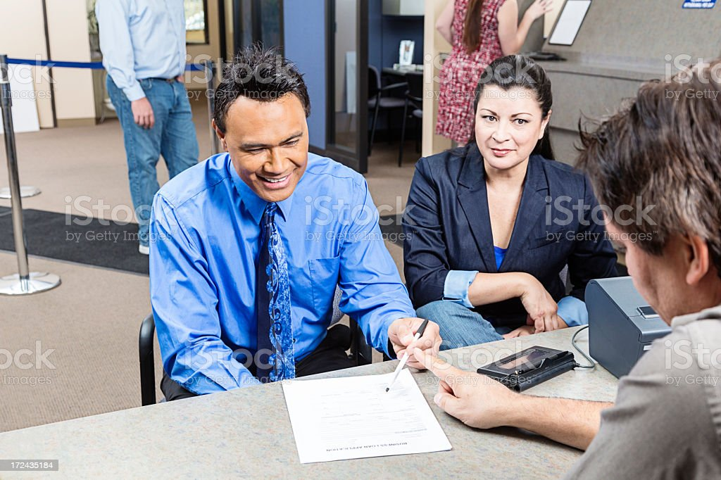 Couple looking for application in the bank stock photo