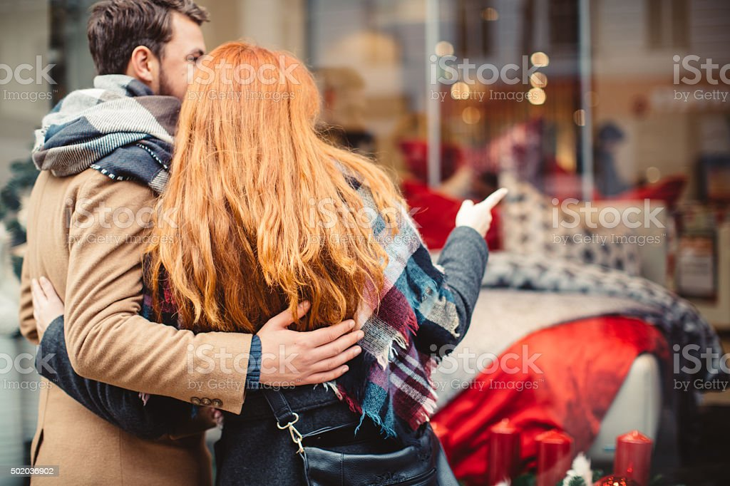 Couple looking for Christmas gifts stock photo