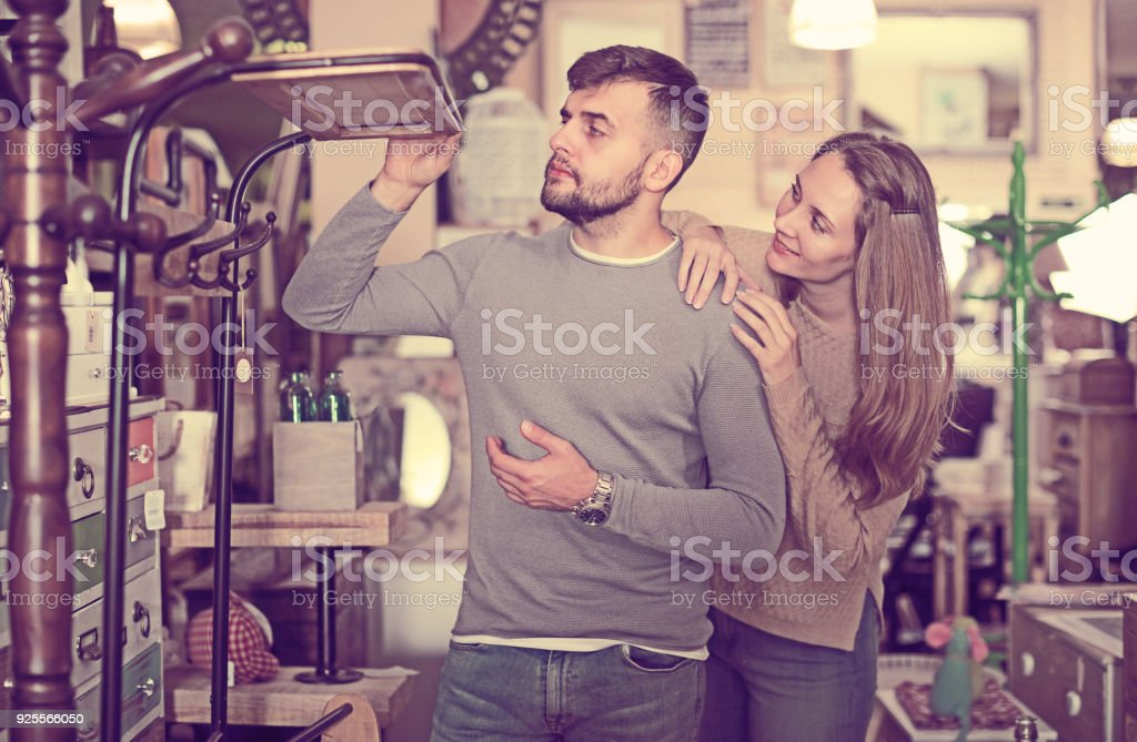Couple looking for hallstand in shop stock photo