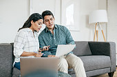istock Couple looking on bank statements 1178695243
