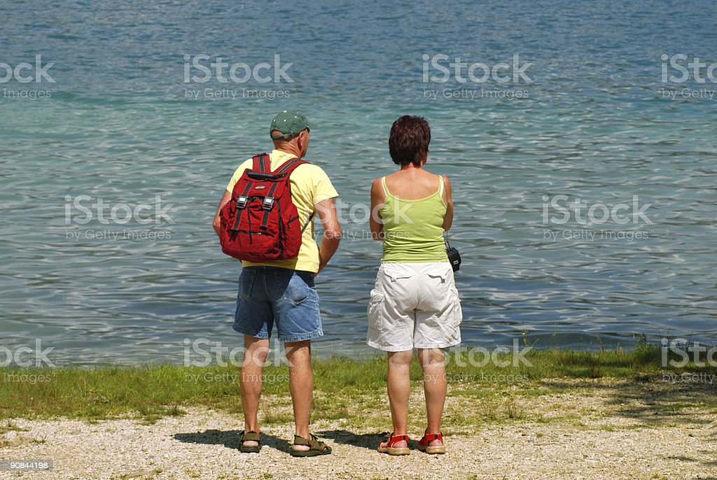 Couple looking on river royalty-free stock photo