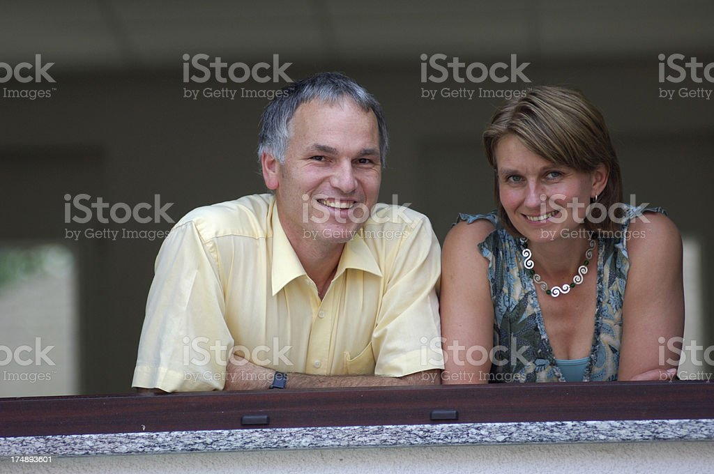 Couple looking out of a window royalty-free stock photo