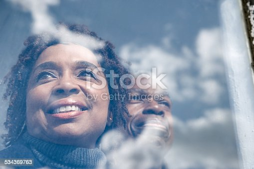 istock Couple looking out of a window 534369763