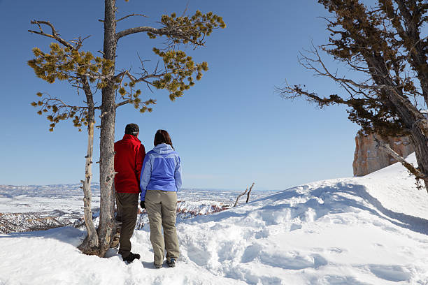 Couple Looking Out Over Bryce Canyon stock photo