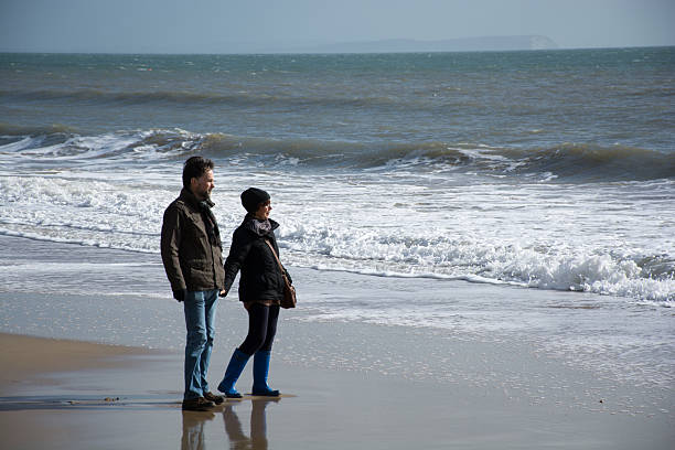 Couple looking out to sea stock photo