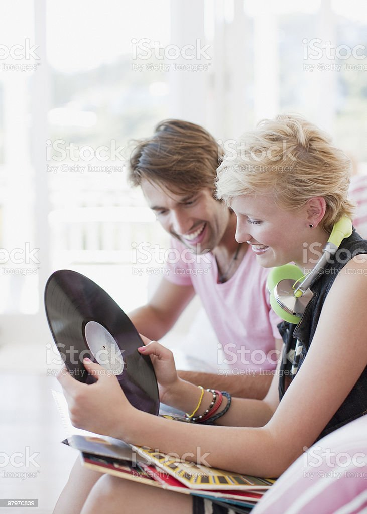 Couple looking through music records royalty-free stock photo