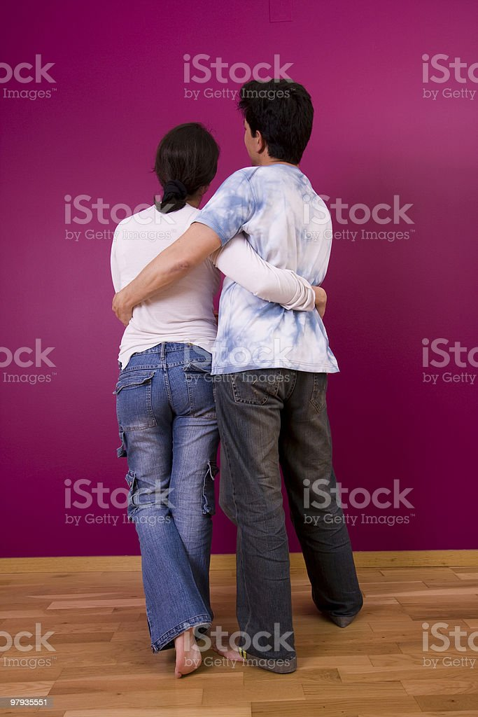 Couple looking to a painted wall royalty-free stock photo