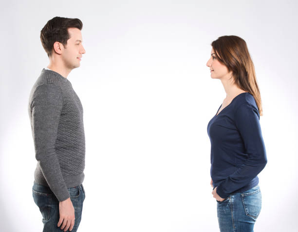 A couple looking to each other A couple looking to each other  on whitebackground face to face stock pictures, royalty-free photos & images