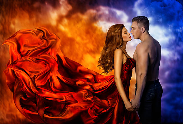 couple love, hot fire woman cold man, romantic kiss - love at first sight stock photos and pictures